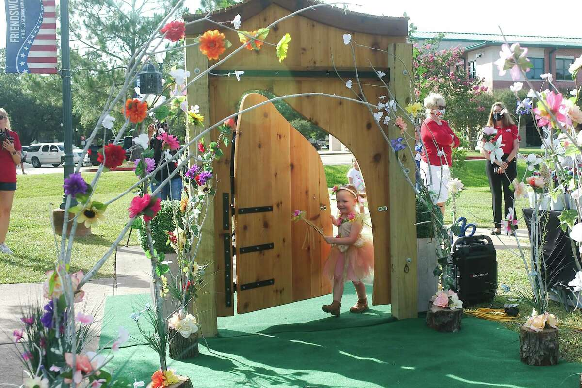 Paisley Wood explores the entrance of the new Fairy Trail at Stevenson Park in Friendswood.