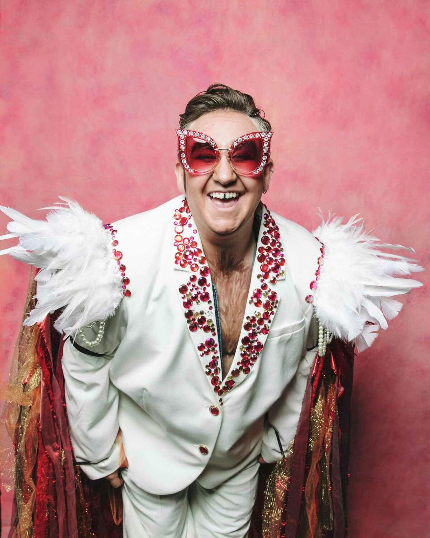 Drag king Vigor Mortis dressed as Elton John.