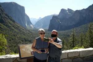 Ken and Debra Copeland take a selfie on June 11, 2020 in Yosemite National Park, California. Yosemite National Park reopened today with many restrictions after shutting down in March to protect people from COVID-19. Only about half of the average June visitors will be allowed in, and they must make an online reservation for each car. The park will issue 1,700 day passes each day and an additional 1,900 passes for reservations at campsites or hotels in the park.