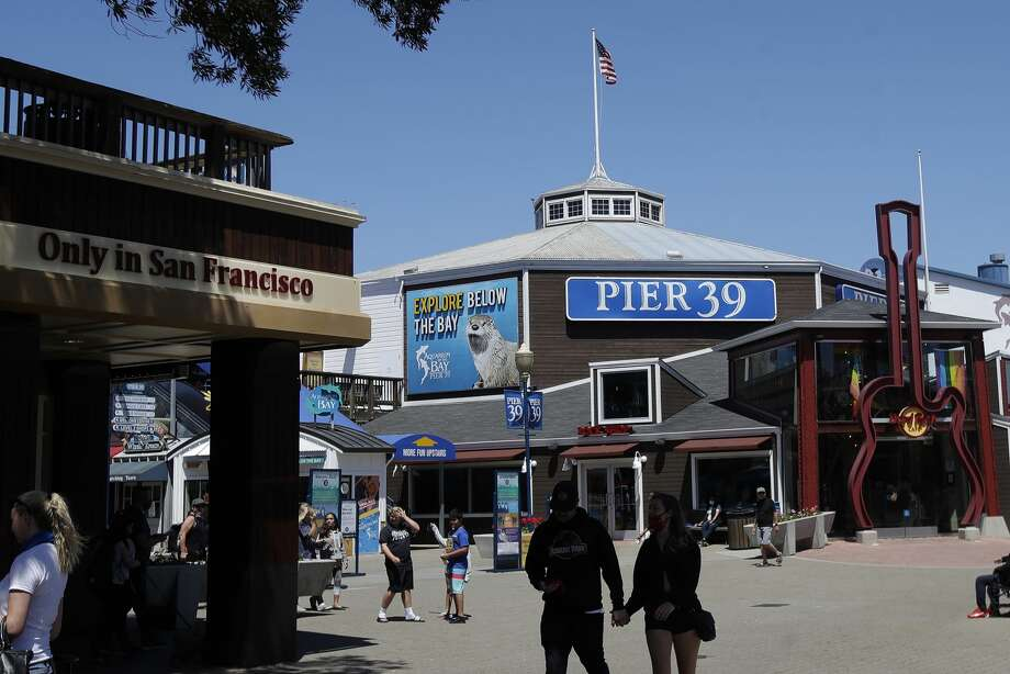 People visit Pier 39, where some stores, restaurants and attractions have reopened, during the coronavirus outbreak in San Francisco, Thursday, June 18, 2020. Photo: Jeff Chiu/Associated Press / Copyright 2020 The Associated Press. All rights reserved
