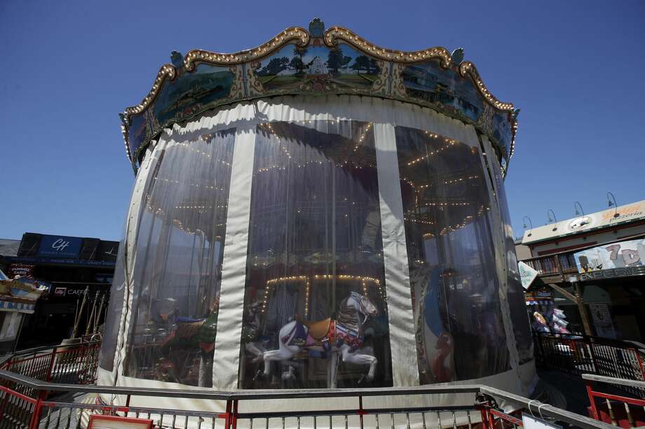 The carousel is shown closed at Pier 39 during the coronavirus outbreak in San Francisco, Thursday, June 18, 2020. Photo: Jeff Chiu/Associated Press / Copyright 2020 The Associated Press. All rights reserved