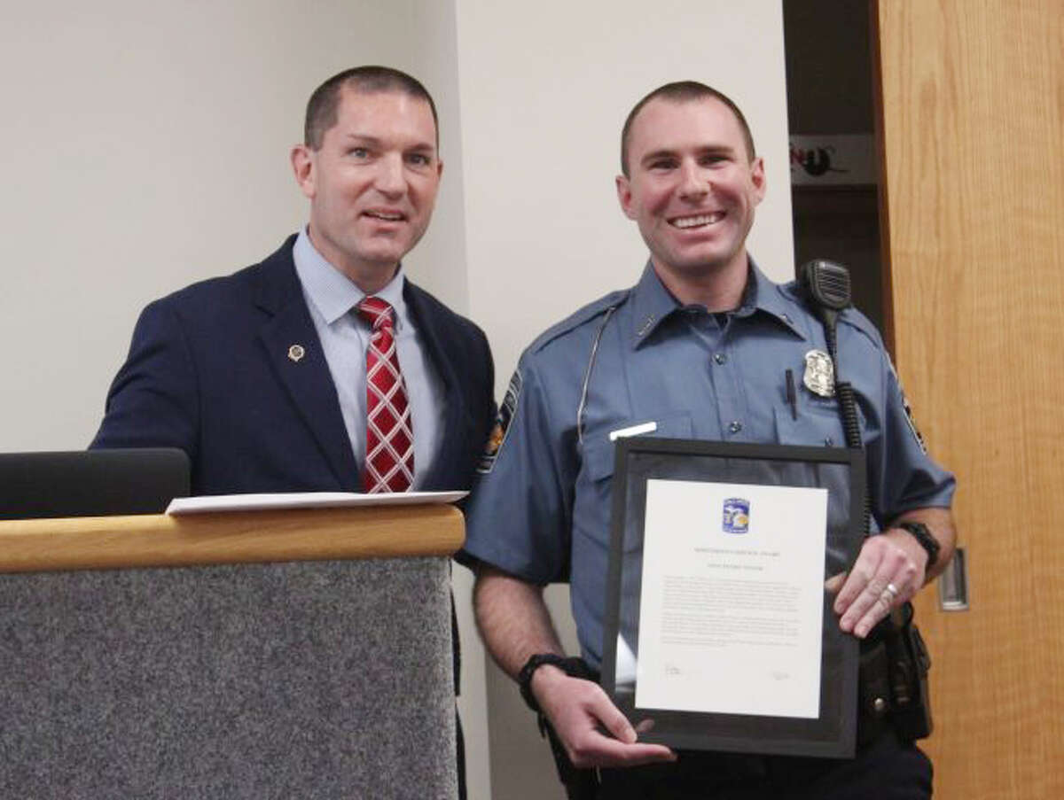 In this May 22, 2018 file photo, Big Rapids Department of Public Safety Director Jim Eddinger (left) presents Eric Winsor with the Meritorious Service Medal during a Big Rapids City Commission meeting. Eddinger praised Winsor's initiative and diligence when performing his duties.