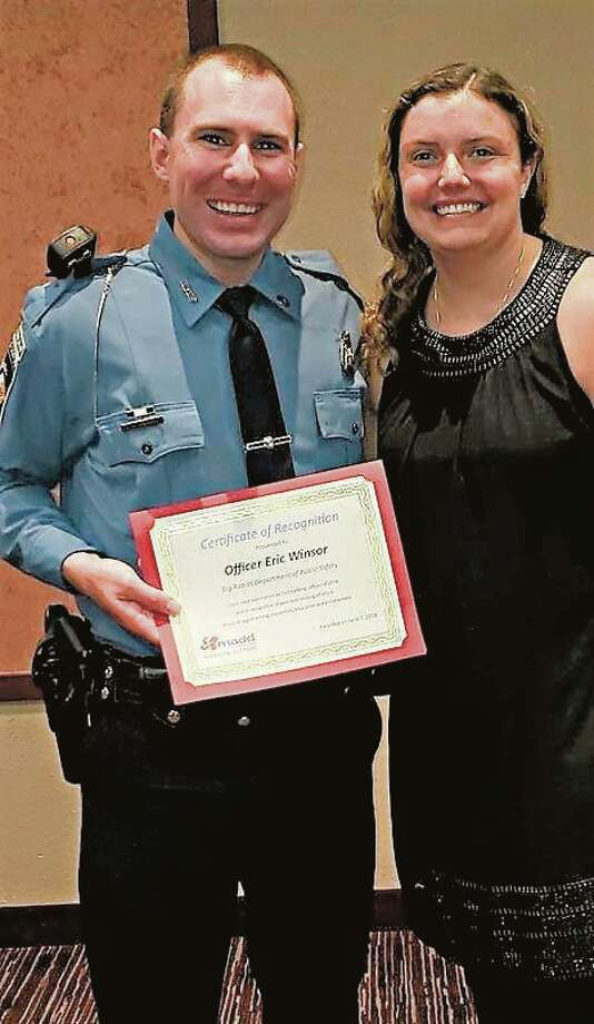 Big Rapids Department of Public Safety Officer Eric Winsor was recognized in 2019 by the Mothers Against Drunk Driving for his work in proactive traffic enforcement. Winsor said his wife Caitlin (right) has always been very supportive of his job. Photo: Submitted Photo