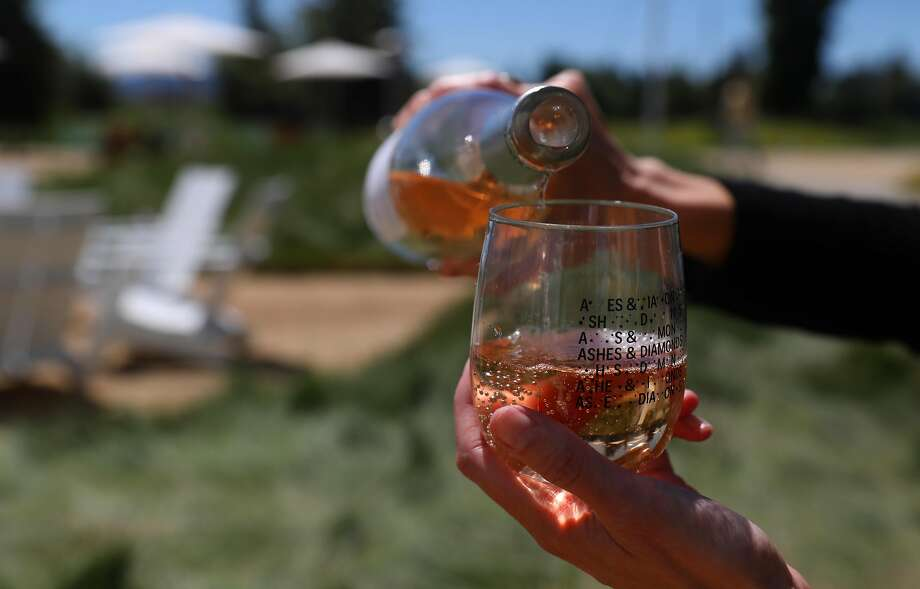 At Ashes & Diamonds winery, guests pour their own wine into plastic glasses, which they can take home with them. Photo: Liz Hafalia / The Chronicle