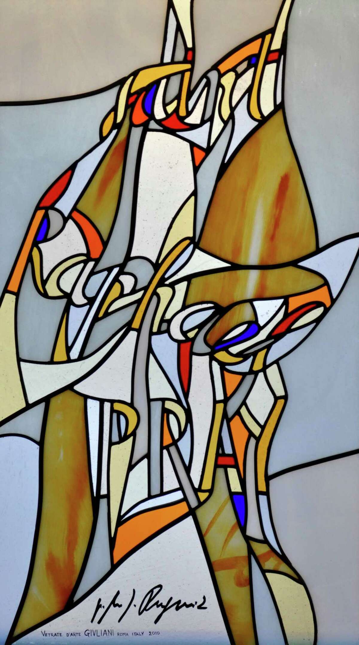 Each of the stained glass windows at the Chapel of the Holy Spirit, on the campus of Sacred Heart University in Fairfield, features a modernist design with splashes of color in which words (rather than images) are interwoven referencing the people and events in the story of salvation. This