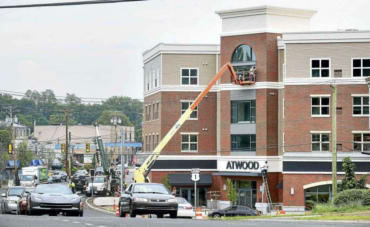 The now completed Atwood, a mixed-use residential and commercial building, on the Boston Post Road in West Haven's Allingtown section is among the developments expected to boost the area economically,