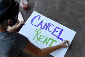 Signs are made ahead of a press conference outside Albany City Hall where housing advocates called on elected officials enact an eviction moratorium and rent cancellation for the duration of the pandemic on Monday, June 22, 2020, in Albany, N.Y. Housing courts reopened on Monday. (Will Waldron/Times Union)