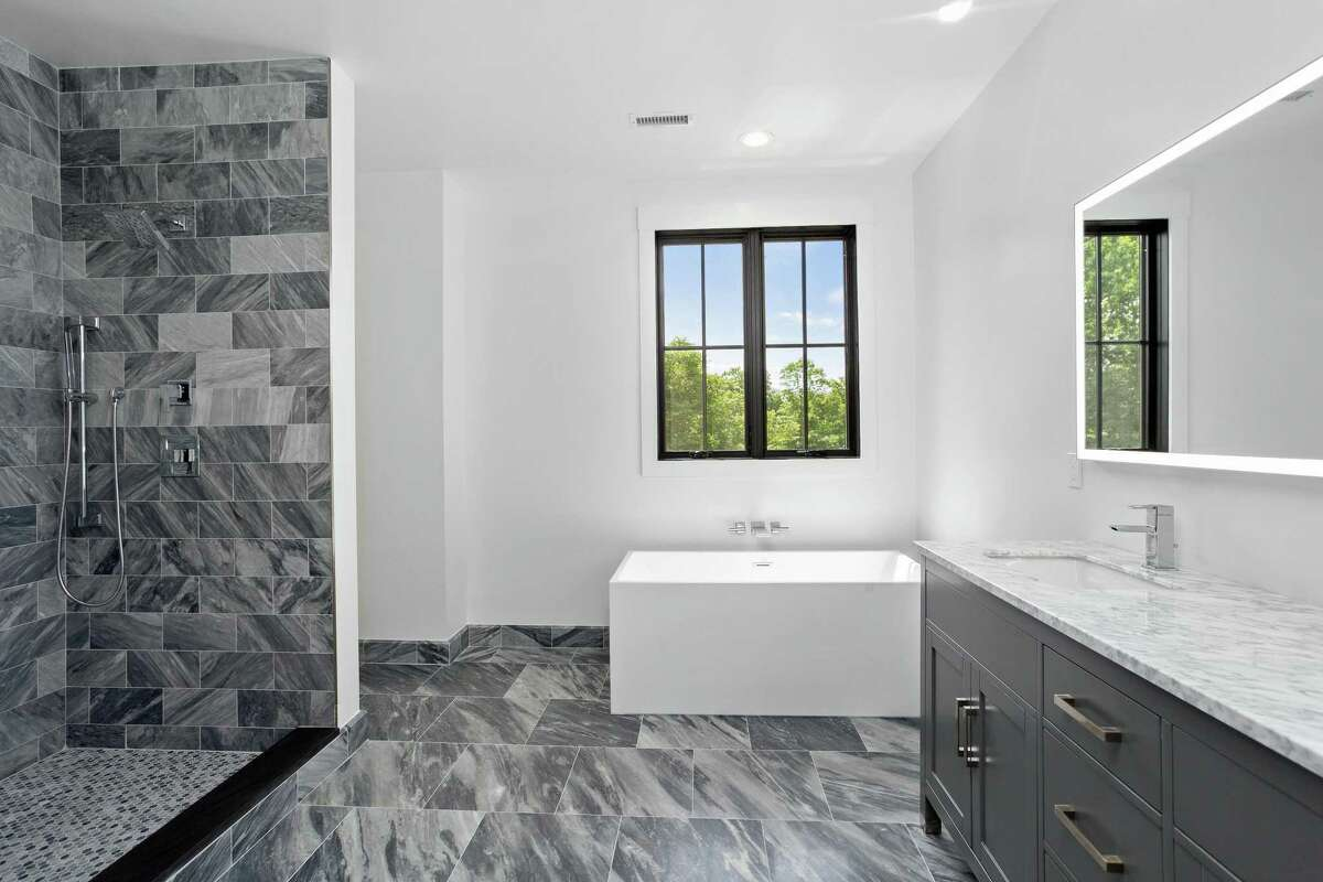 The luxurious spa-like master bath features Italian imported Bardiglio marble in the heated floor and walk-in shower. There is also double marble vanity.