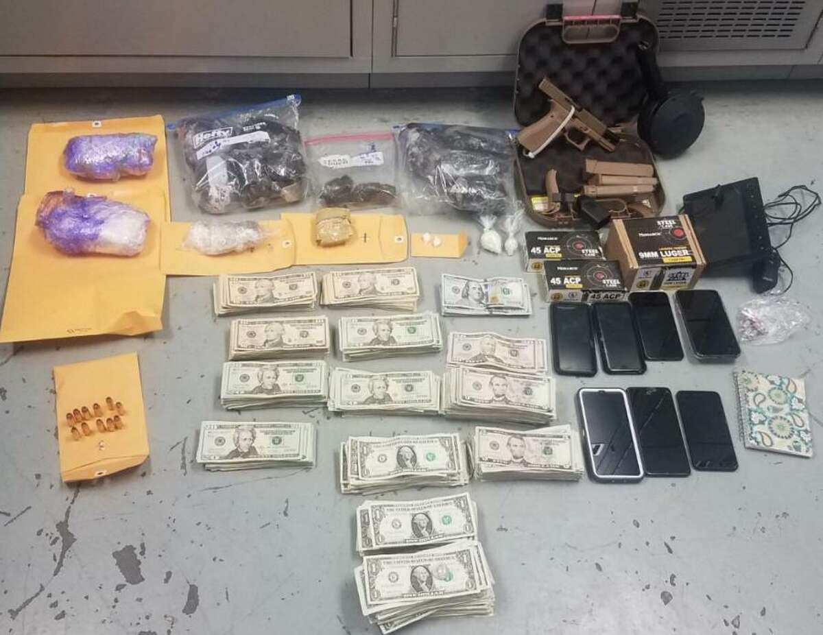 Laredo police assisted by state and federal authorities seized the items shown in this photo and also arrested three people in connection with a recent raid in El Trompe neighborhood.