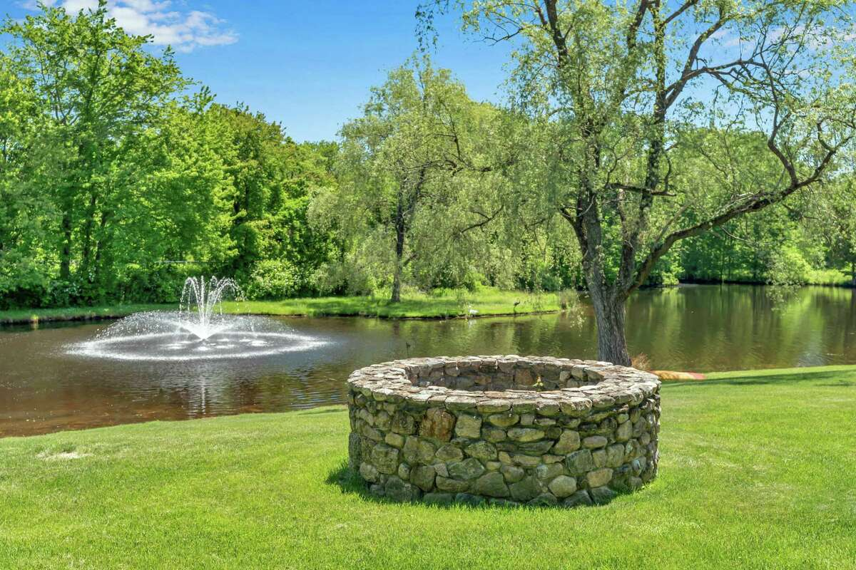 The pond on the front of the property has an aerated water/fountain feature.