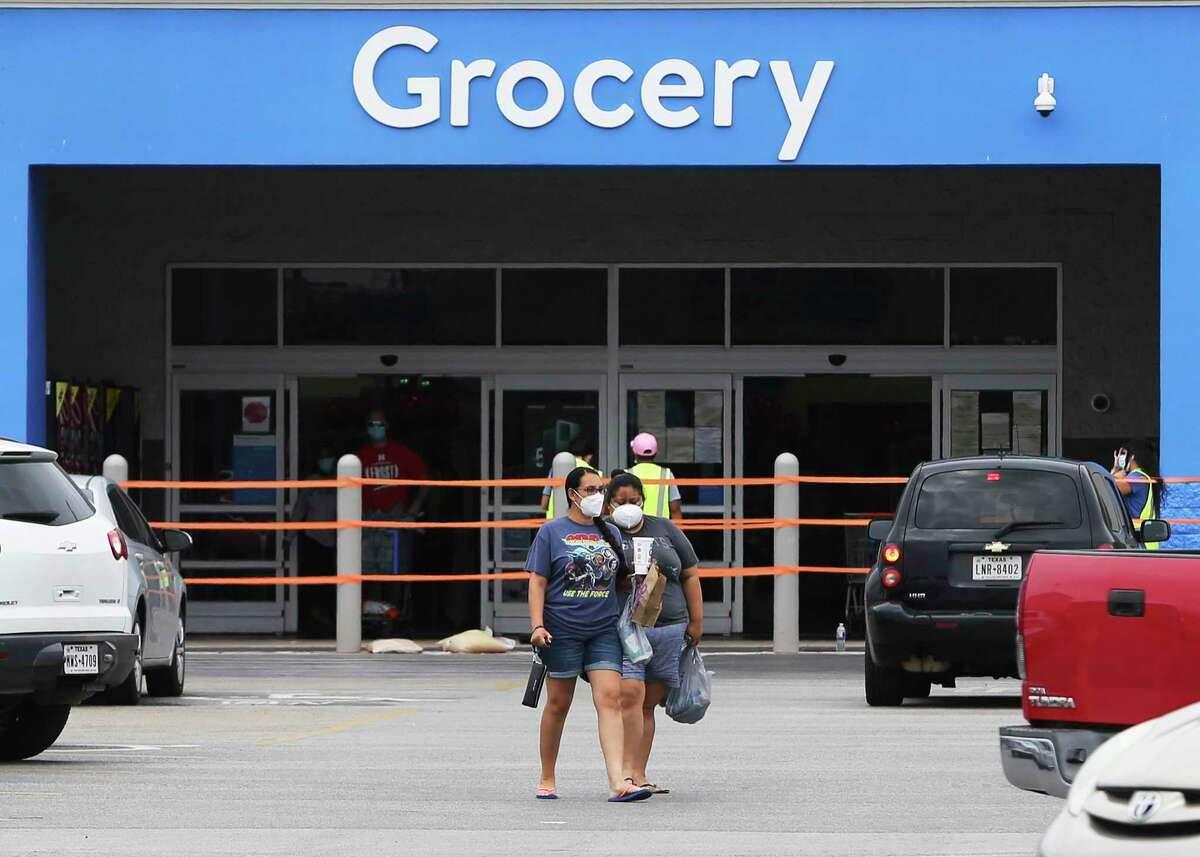 Shoppers leave a Walmart as the latest mask order takes effect Monday, June 22, 2020.