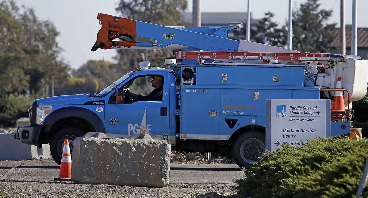 In this Feb. 11, 2020, file photo, a Pacific Gas & Electric truck leaves the company's Oakland Service Center in Oakland, Calif.