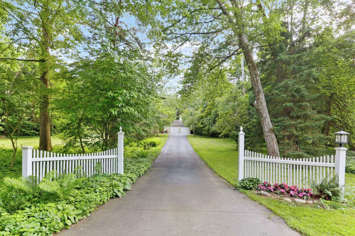 White picket fences mark the entrance to this Connecticut property. White picket fences A white picket fence is the quintessential mark of suburbia - especially in New England, Schwartz said. They also add to a home's curb appeal, which can potentially increase the property value.
