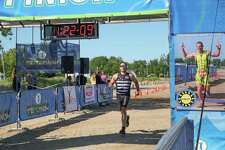 Organizers of the annual Caseville Triathlon/Duathlon have announced this year's event has been canceled. Above, a competitor crosses the finish line during the 2019 event. (Tribune File Photo)