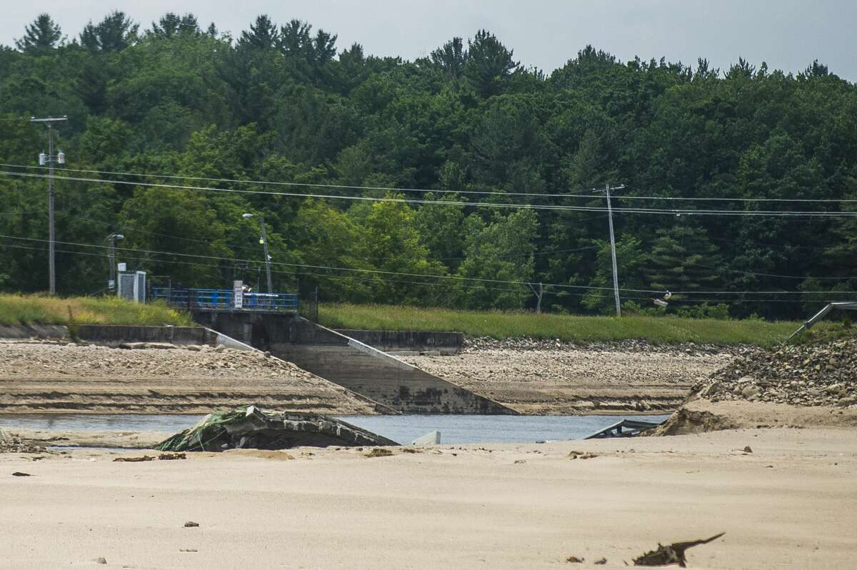 The Edenville Dam is seen through the area where the M-30 bridge once stood over Wixom Lake near Stryker's Marina in Tobacco Township Monday, June 22, 2020. (Katy Kildee/kkildee@mdn.net)