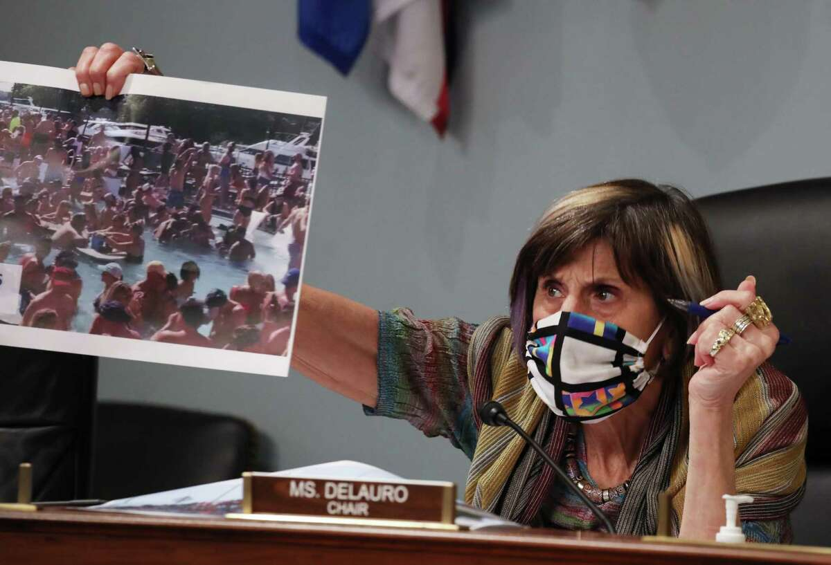 WASHINGTON, DC - JUNE 04: Chairwoman Rosa DeLauro (D-CT) of the Labor, Health and Human Services, Education and Related Agencies subcomittee holds a photograph taken at the Lake of the Ozarks in Missouri on Memorial Day weekend during a hearing attended by Centers for Disease Control and Prevention Director Robert Redfield on June 4, 2020 in Washington, DC. Redfield was expected to testify on the agency's response to the novel coronavirus pandemic and about concerns of the effects the protests across the country over the death of George Floyd might have on the fight against the virus. (Photo by Tasos Katopodis-Pool/Getty Images)