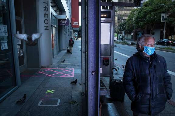 Juventino Barojas stands in the bus stop where he sleeps on Mission Street in San Francisco. Calif., on Wednesday, May 27, 2020. Barojas, a former hotel worker who grew up in Puebla Mexico, is a homeless senior citizen and lives on the streets of the city during the coronavirus pandemic.