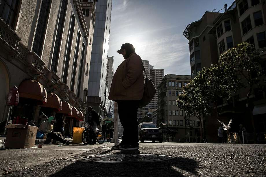 Michael Halpin, 69, stands on Ellis Street hoping to speak to someone about getting a hotel room at Glide Memorial Church in San Francisco. Calif., on Friday, May 22, 2020. Homeless senior citizens are having greater level of risk living on the streets of the city during the coronavirus pandemic. Photo: Carlos Avila Gonzalez / The Chronicle