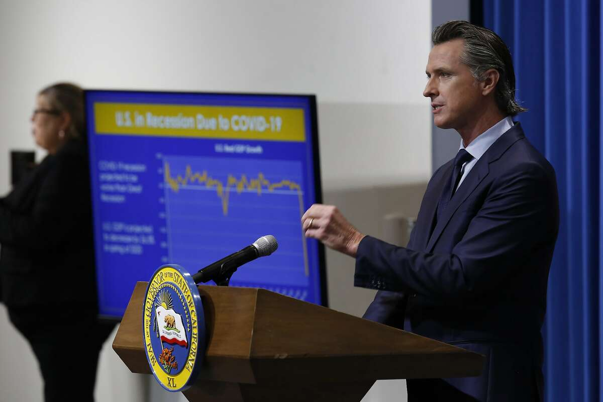 FILE - In this May 14, 2020 file photo Gov. Gavin Newsom discusses his revised 2020-2021 state budget during a news conference in Sacramento, Calif. In a joint statement Newsom and the Democratic Leaders of the Legislature announced on Monday June 22, 2020, that they have agreed to a state spending plan that would cover the state's estimated $54.3 billion dollar budget deficit. (AP Photo/Rich Pedroncelli, Pool, File)