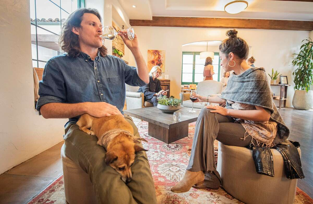 Nick Dealy (with dog Hazel Mae) and Kara Marable of Santa Barbara drink wine at the Grassini tasting room on Thursday, April 4, 2019, in Santa Barbara, Ca.