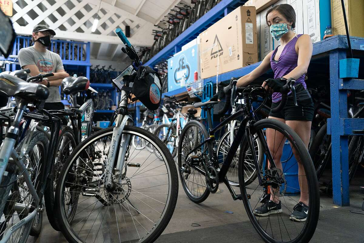 Alicia Menendez is helped by Winston Anyarin for her first new bike she is considering buying at Blazing Saddles, a long-standing bike rental store, which is now also selling them because of the new demand on Monday, May 25, 2020, in San Francisco, Calif.