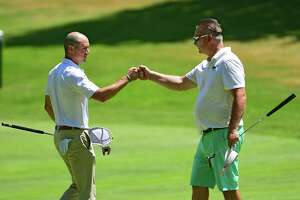 Daniel Kinn of Acushnet Company, left, fist bumps with Tom Oppedisano after finishing on the 18th green during the Northeastern New York PGA Pro Classic 3 at Pinehaven Country Club on Monday, June 22, 2020 in Guilderland, N.Y. (Lori Van Buren/Times Union)
