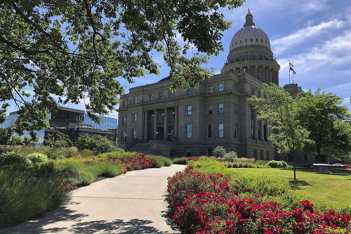 FILE - This June 13, 2019, file photo, shows flowers blooming on a walkway to the Idaho State Capitol in Boise, Idaho. The Trump administration is supporting Idaho's new law banning transgender women from competing in women's sports. It's the first law of its kind in the nation and the U.S. Department of Justice backed it in a court filing Friday, June 19, 2020. (AP Photo/Keith Ridler, File)