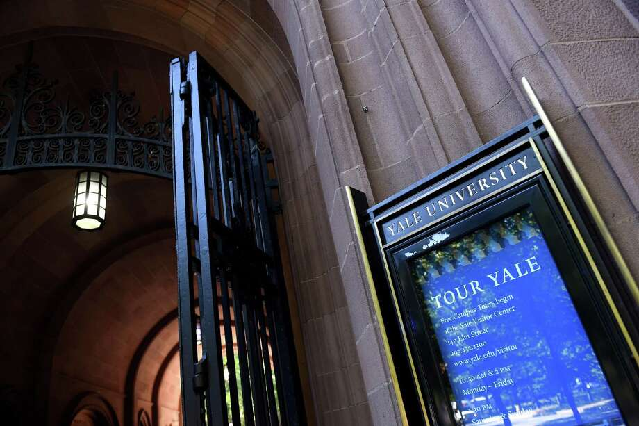 A sign advertises Yale University tours at the Phelps Gate entrance to Yale University in New Haven. Photo: Arnold Gold / Hearst Connecticut Media / New Haven Register