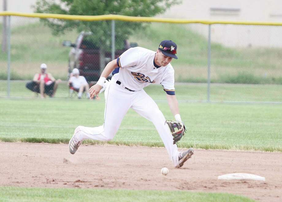 Manistee Saints shortstop Nate Lange eyes a ground ball Saturday during the team's season opener. (Dylan Savela/News Advocate file photo)