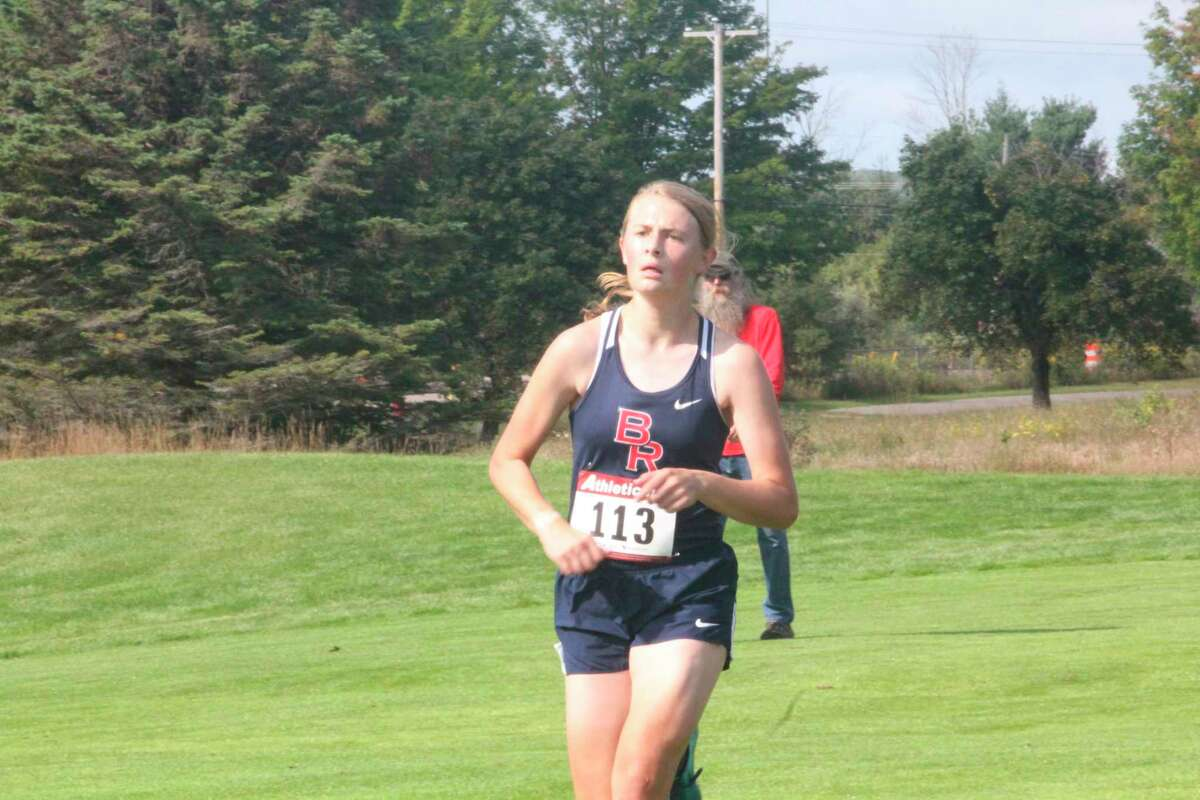 Big Rapids' Kate Langworthy nears the end of the finish line at Katke Golf Course during the Ferris Invitational last September. (Pioneer file photo)