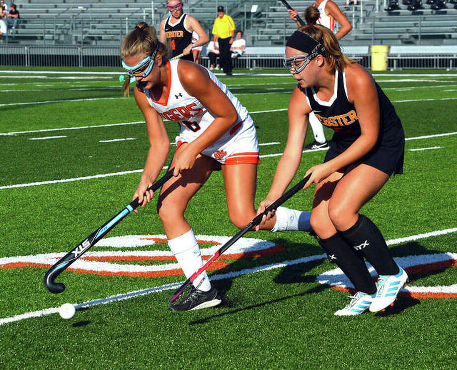 Edwardsville's Chesca Ballosini, left, tries to keep the ball away from a Webster Groves defender during a game last season. Photo: Scott Marion/The Intelligencer