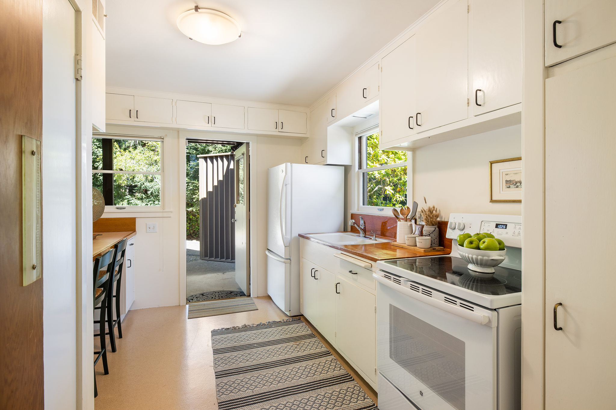 A bright kitchen in the guesthouse steps out onto the courtyard.