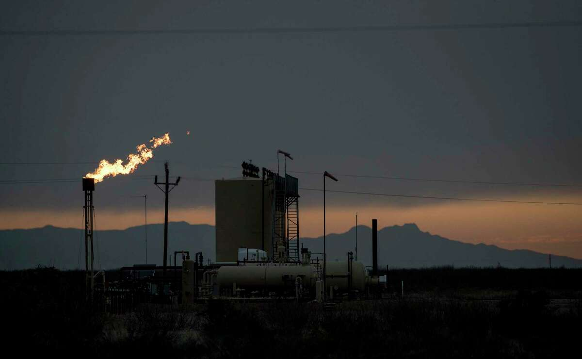 A flare burns in Pecos County. The oil bust has reduced flaring in the Permian Basin.