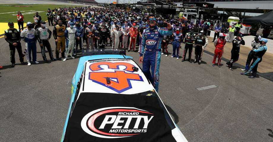 Bubba Wallace, driver of the #43 Victory Junction Chevrolet, takes a selfie with NASCAR drivers that pushed him to the front of the grid as a sign of solidarity with the driver prior to the NASCAR Cup Series GEICO 500 at Talladega Superspeedway on June 22, 2020 in Talladega, Alabama. A noose was found in the garage stall of NASCAR driver Bubba Wallace at Talladega Superspeedway a week after the organization banned the Confederate flag at its facilities. (Photo by Chris Graythen/Getty Images) Photo: Chris Graythen/Getty Images / 2020 Getty Images