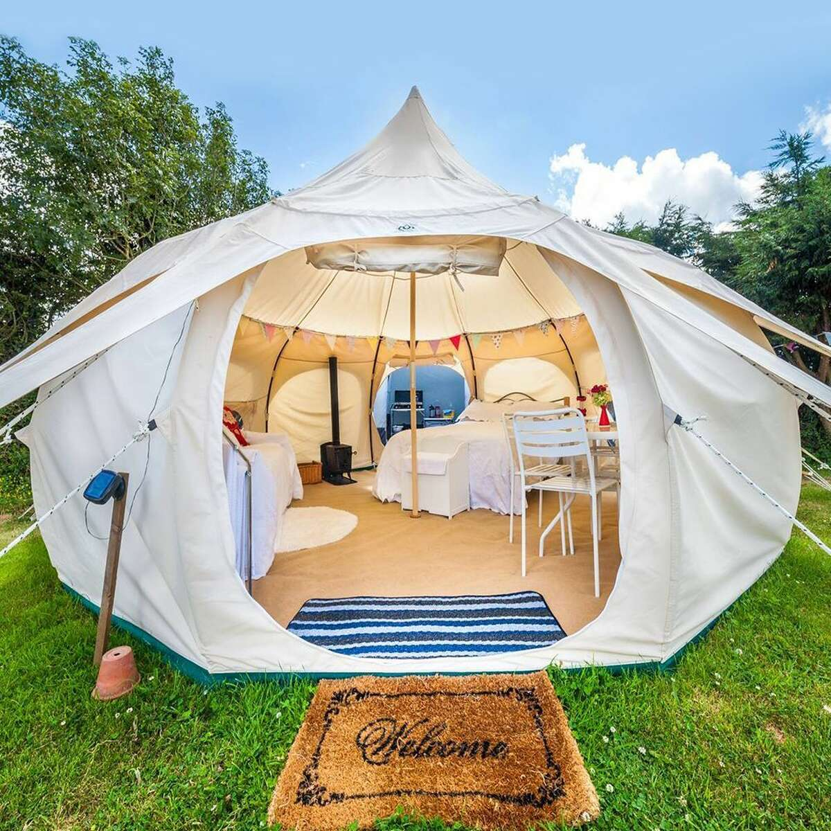 1) Lotus Belle 16-Foot Outback Deluxe Glamping Tent: $2800.00 Shop Now Grab your glamping martini glass and settle in for a while! If this tent seems like something out of a fairytale, that's because it practically is. This 16-by-16-foot bell-shaped tent is big enough to fit six (yes, six!) twin-sized mattresses, or for six people to practice yoga comfortably. This deluxe tent has two mesh windows and two roof vents to maximize airflow, an oversized zip-up front door that is wide enough for a queen-sized bed to fit through, and plenty of exterior tie-downs to keep things secure if the wind picks up. This Lotus Belle is the definition of a glamping tent, with so much comfort that you might never want to go home! More: These Glamping Destinations Are What Dreams Are Made Of