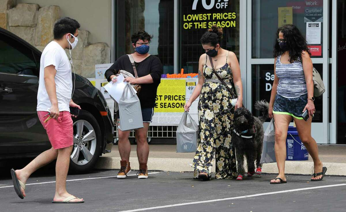 Shoppers wearing masks walk out of Michael's at the Quarry as the first day of Bexar County Judge Nelson Wolff's mask order takes effect on Monday, June 22, 2020. After days of sharp rises of Covid-19 infection results, Wolff declared a new order for businesses in the county to require customers to wear masks.