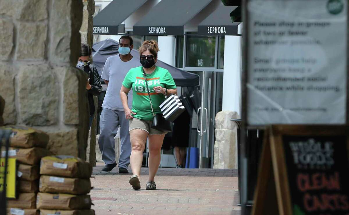 Shoppers wear masks near Whole Foods at the Quarry as the first day of Bexar County Judge Nelson Wolff's mask order takes effect on Monday, June 22, 2020. After days of sharp rises of Covid-19 infection results, Wolff declared a new order for businesses in the county to require customers to wear masks.