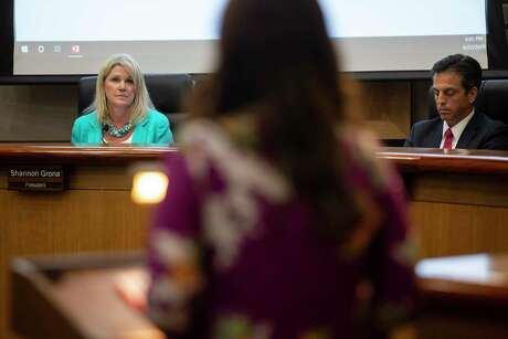 North East ISD board president Shannon Grona and Superintendent Sean Maika listen to comments at a budget meeting in June.