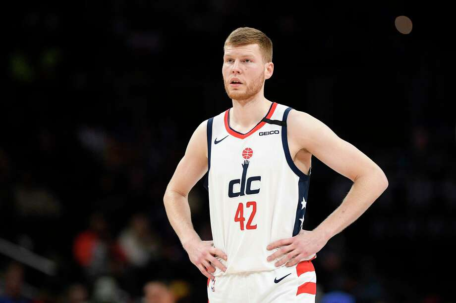FILE - In this Feb. 3, 2020, file photo, Washington Wizards forward Davis Bertans (42), of Latvia, stands on the court during the second half of an NBA basketball game against the Golden State Warriors, in Washington. Wizards forward Davis Bertans will skip the Orlando-based resumption of the NBA season. He is the first known example of a healthy, eligible player sitting out. Bertans' decision was first reported Monday, June 22, 2020, by ESPN and confirmed to The Associated Press by a person familiar with his plans, speaking on condition of anonymity because neither the player nor team had made an announcement.(AP Photo/Nick Wass, File) Photo: Nick Wass / Copyright 2020 The Associated Press. All rights reserved