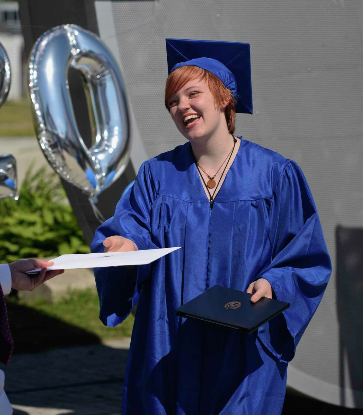 Kelsey Hall, of Danbury, culinary arts, smiles as she receives her diploma at the 2020 Abbott Technical High School graduation on Monday, June 22 in Danbury.
