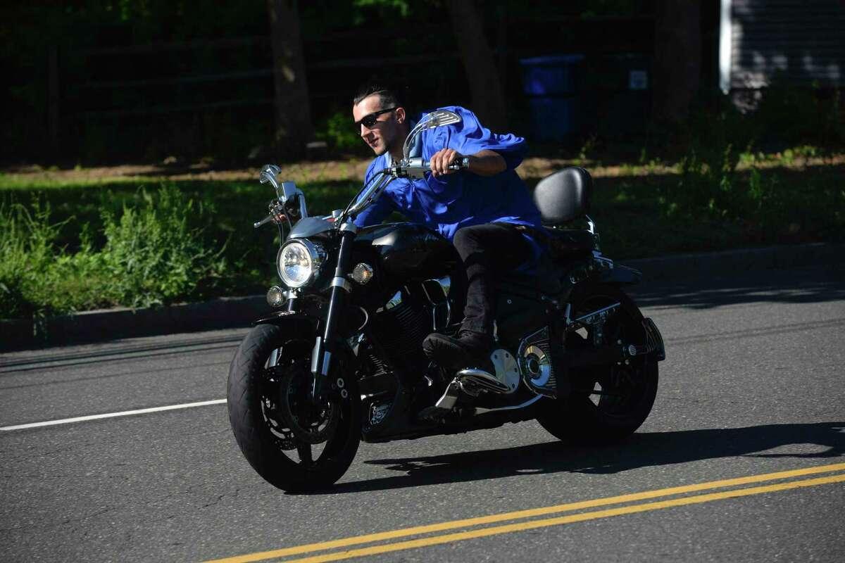 Daniel Oliveira, of Danbury, Automotive Technology rides away from the 2020 Abbott Technical High School graduation. Monday, June 22, 2020, in Danbury, Conn.