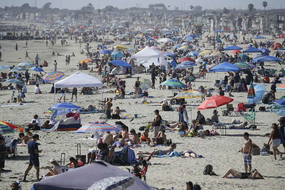 FILE - In this May 24, 2020, file photo, visitors gather on the beach in Newport Beach, Calif., during the coronavirus outbreak.  (AP Photo/Marcio Jose Sanchez, File) Photo: Marcio Jose Sanchez, Associated Press