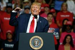 In this June 20, 2020, photo, President Donald Trump speaks during a campaign rally at the BOK Center in Tulsa, Okla.