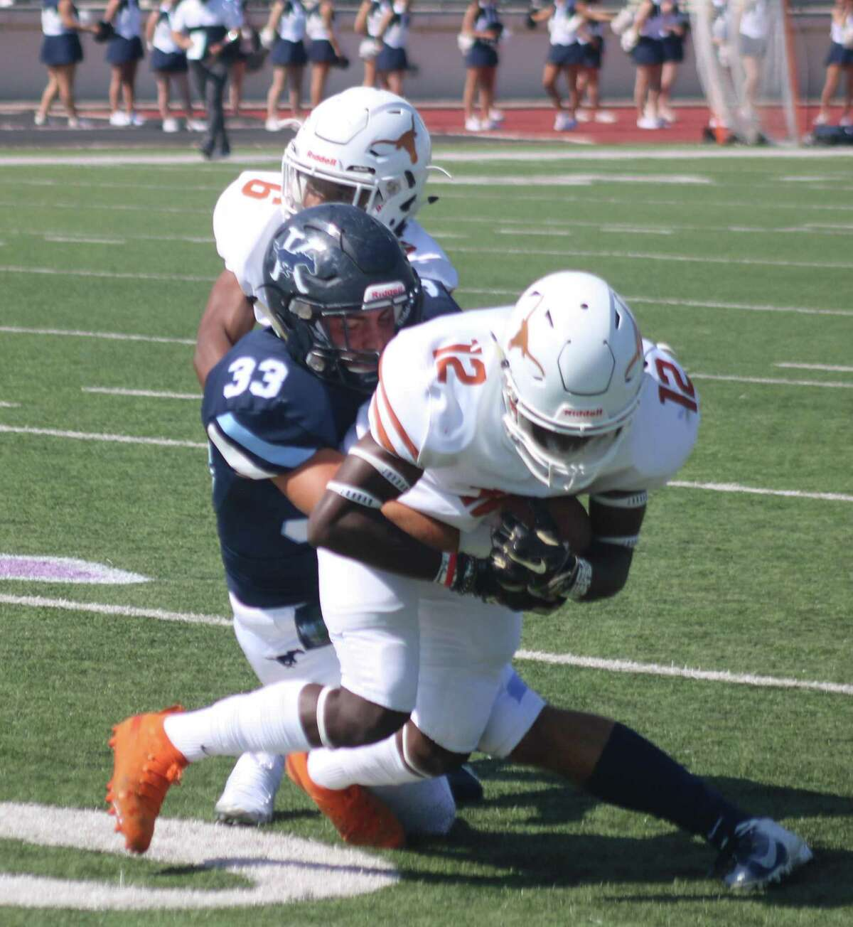 Fumble recoveries, such as this one by Dobie's defense against Kingwood, were one reason for the Longhorns defense totaling four shutouts last season, the most since 1999. Coach Kevin Berneathy's crew is now in strength and conditioning work, getting healthy participation.
