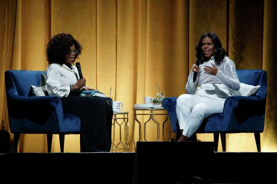 Michelle Obama, right, and Oprah Winfrey at the United Center Nov. 13, 2018 in Chicago. Photo: Armando L. Sanchez / TNS / Chicago Tribune