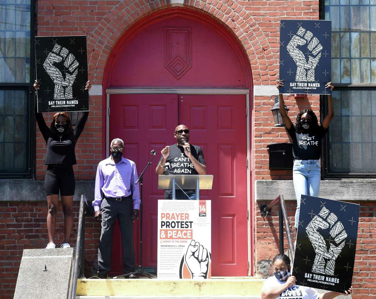 Rev. Kelcy G.L. Steele speaks at The Prayer, Protest & Peace March in front of the Varick Memorial AME Zion Church in New Haven on June 14, 2020.