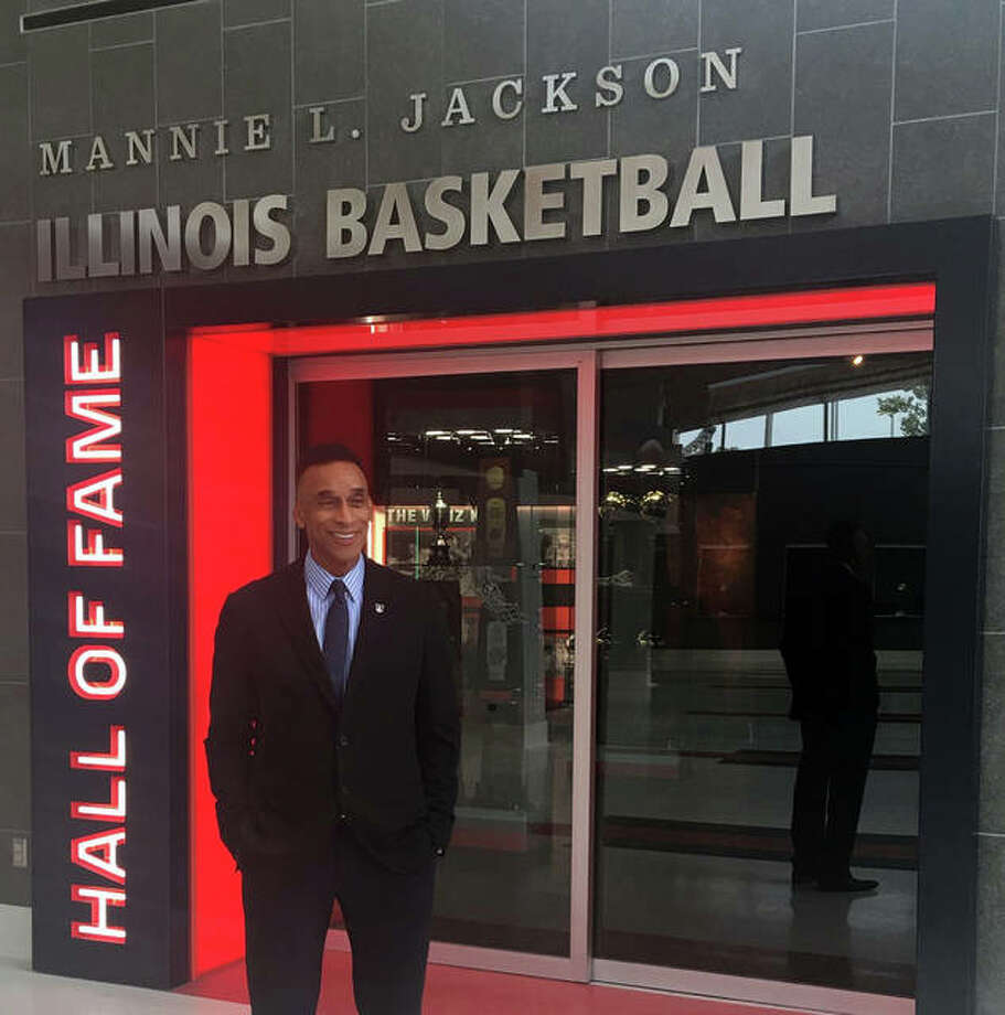Mannie Jackson poses in front of his exhibit at the Illinois Basketball Hall of Fame at the State Farm Center in Champaign.