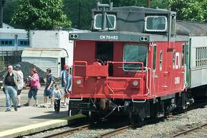 Visitors depart a train after a short ride during the 10th annual Railway Days at the Railway Museum in Danbury. Sunday, Aug 7, 2016