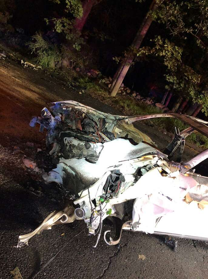 This 2016 Maserati Ghibli crashed Monday night on Westhill Road and burst into flames. The 22-year-old driver was taken to the Bridgeport Hospital Burn Unit and is in critical condition. Photo: Stamford Police Department Photo