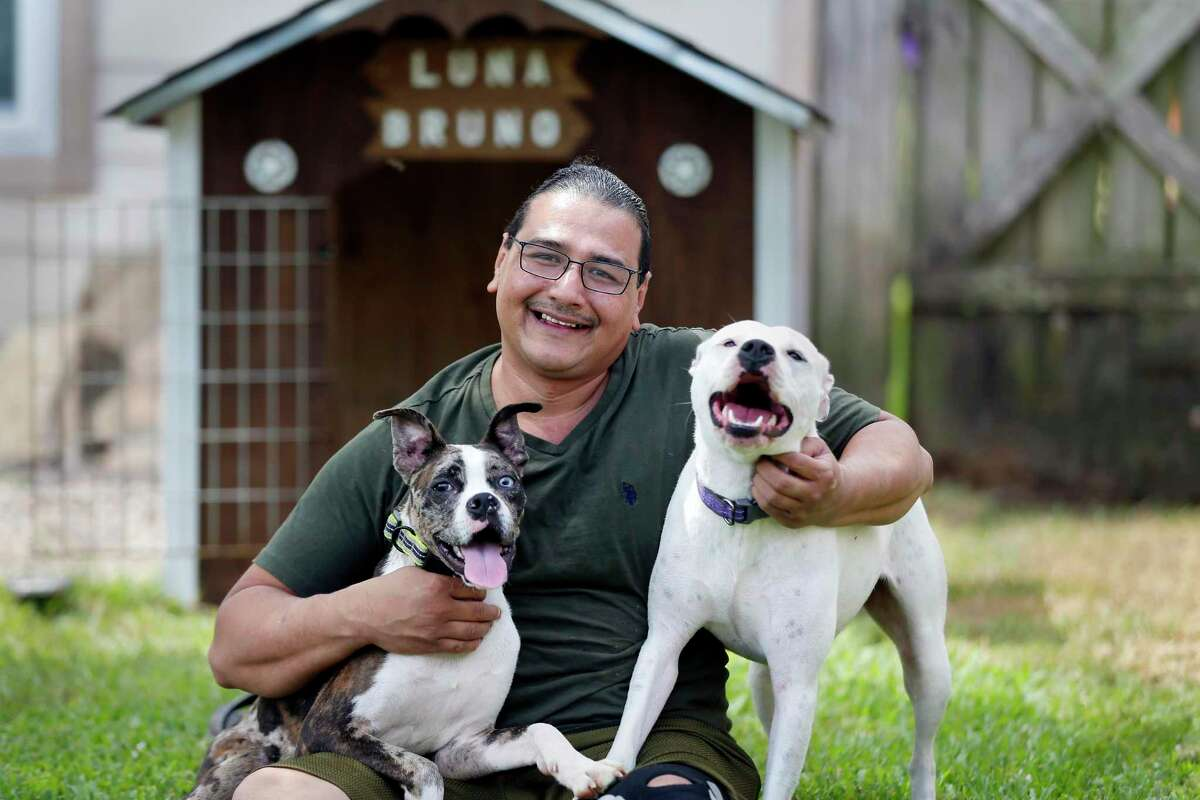 Francisco Montez is taking steps to prepare Luna, right, and Bruno for the day he and his family return to their offices and stop working from home.